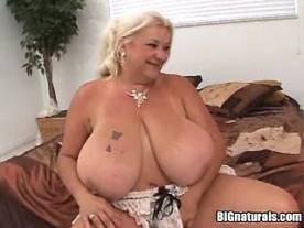 Chubby granny with very big tits gets crazy titsfuck