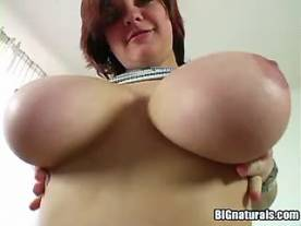 Busty redhead babe shows her huge boobs in home