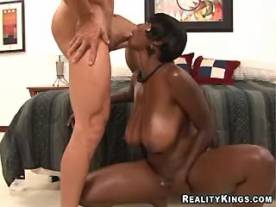 Sexy ebony with huge melons sucks cock and titsfucks