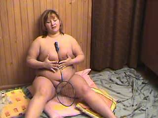 Fat busty whore plays with tennis racket on floor