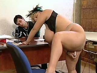 Chesty plump secretary sucking cock in office