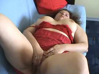 Lonely chubby girl plays with her shaved pussy