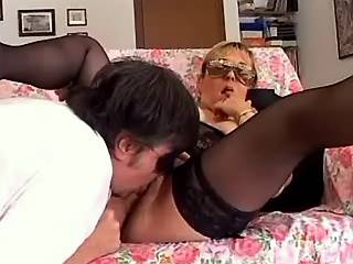 Chubby mature whore in mask and guy make oral sex