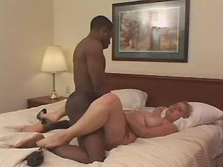 Chubby blonde with round tits fucked by black cock