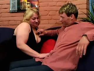 Fat blonde whore dances strip-tease and licked