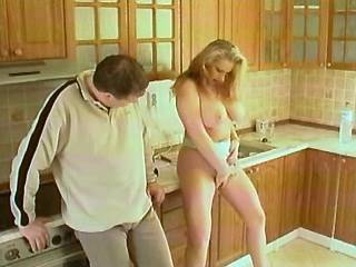 Blonde plumper with big boobs titsfucks on kitchen