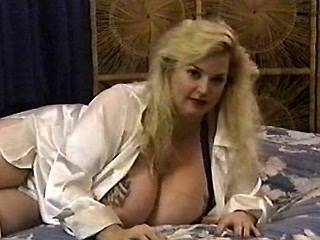Fat mature in high boots present massive melons