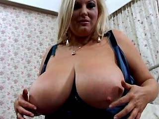 Blonde fatty gets cum on big appetizing melons