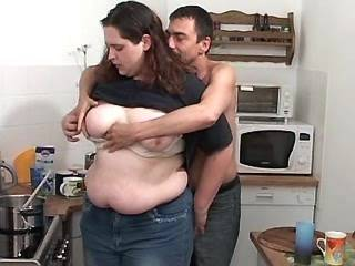 Teen fatty spoils man on kitchen and titsfucks