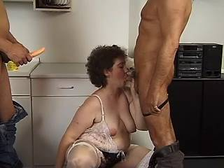 Plump mature in stockings sucks and dildofucks