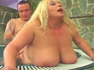 Big mature lady gets cum on massive boobs in pool
