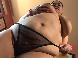 Horny asian fatty with big tits sucks black cock