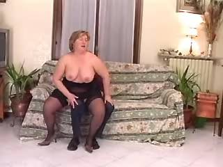 Chubby whore in stockings greedily sucks hard cock