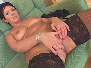 Plump mature in stockings sucks chocolate cock