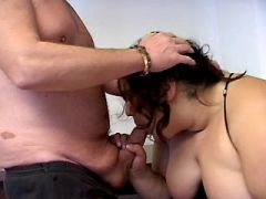 Enormous whore greedily sucks cock of older man
